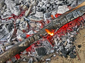 Abstract bonfire with hot carmonized wooden coal, picnic. — Stock Photo