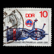 Post stamp printed in Germany shows spaceship and portrait of scientist Albert Einstein. - Stock Photo