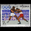 Stamp printed in Poland shows boxers on the olympic ring devoted to 19th Olympic Games (Mexico City, 1968),circa 1967. — Stock Photo #11969130