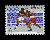 Stamp printed in Poland shows boxers on the olympic ring devoted to 19th Olympic Games (Mexico City, 1968),circa 1967. — Stock Photo