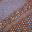 Cable broadband as text on metal surface, telecommunications. - Stock Photo