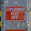 Stock Photo: Explosives keef off, warning message on red signboard.