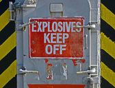 Explosives keef off, warning message on red signboard. — Stock Photo