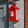 Red fire alarm station on brick wall, security details. — Stockfoto #12039154