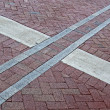 Abstract cross sign on red brick square, architecture details. — Stok fotoğraf
