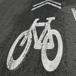 White bike painted sign on grunge asphalt, transportation. — Stock Photo
