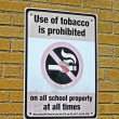 Use of tabacco prohibited in all schools as message on sigbboard. - Stock Photo