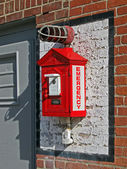 Red fire alarm station on the brick wall, security details. — Stok fotoğraf