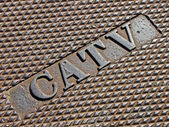 Cable television as text on vintage metal manhole, telecom. — Stock Photo