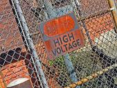 Danger - high voltage as warning message on vintage signboard. — Stock Photo