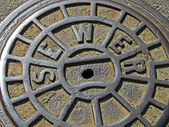 Metal sewer manhole, industry details. — Stock Photo
