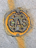 Vintage yellow gas manhole, energy details. — Stock Photo
