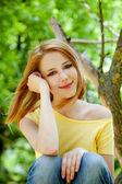 Redhead girl at summer park. — Stock Photo