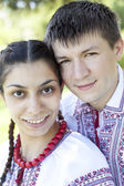 Slav girl and young cossack at nature. — Stock Photo