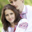 Slav teens in national Ukrainian clothing. - Stock Photo