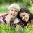 Young teenage couple in green park. — Stock Photo #11138034