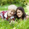 Young teenage couple in green park. — Stock Photo