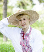 Young slav teen at green meadow in national clothing. — Stock Photo