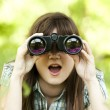 Teen girl with binocular at green grass — Stock Photo
