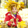 Stock Photo: Child in autumn park.