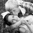 Young teenage couple in park. Photo in black and white style. — Stock Photo
