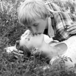 Young teenage couple in park. Photo in black and white style. — Stock Photo #11233612