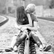 Royalty-Free Stock Photo: Couple kissing at railway. Urban photo.