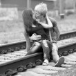 Couple kissing at railway. Urban photo. — Stock Photo