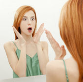 Surprised young woman in bathroom — Stock Photo
