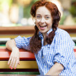 Funny hipster girl on the bench at the street - Stock Photo
