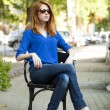 Style redhead girl sittin in the chair in the cafe - Stock Photo