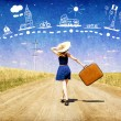 Lonely girl with suitcase at country road dreaming about travel. — Stock Photo