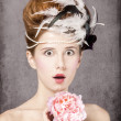 Surprised redhead girl with Rococo hair style and flower at vint — Stock Photo