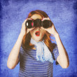 Stock Photo: Americredhead girl in suglasses with binocular