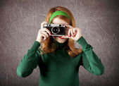 American redhead girl with camera. — Stock Photo