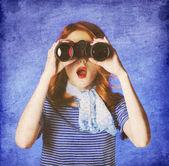 American redhead girl in suglasses with binocular — Stock Photo