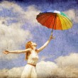 Girl with umbrella at sky background. — Stock Photo