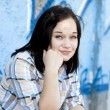 Style teen girl near graffiti background. — Stock Photo