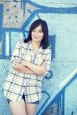 Style teen girl near graffiti background. — Stock Photo
