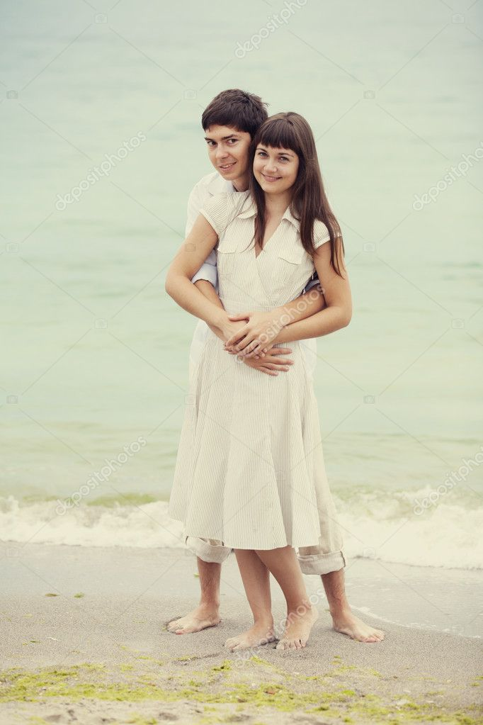 Closeup portrait of happy couple enjoying vacations on the beach  Stock Photo #11651508