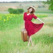 Royalty-Free Stock Photo: Redhead girl with suitcase at outdoor.