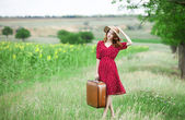 Redhead girl with suitcase at outdoor. — Stock Photo