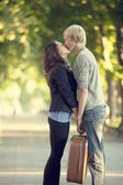 Young couple kissing on the street — Stock Photo