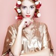 Redhead girl with curlers — Stock Photo #12047538