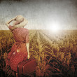 Redhead girl with suitcase at corn field. — Stock Photo #12254724