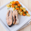 Salmon steaks with vapor cooked veggies - Stock Photo