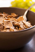 Integral cereal flakes for breakfast — Stock Photo