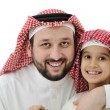Arabian son and his father wearing keffiyeh — Stock Photo #11747408