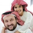 Adult and child with middle eastern clothes — Stock Photo