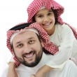 Adult and child with middle eastern clothes — Stock Photo #11747431